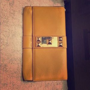 Vince Camuto leather clutch with gold hardware